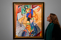 © Licensed to London News Pictures. 29/01/2020. LONDON, UK. A staff member views ''Le Cycliste'' by Jean Metzinger, (Est. £1,500,000 - 2,000,000). Preview of Sotheby's Impressionist & Modern and Surrealist Art sales.  The auction will take place at Sotheby's New Bond Street on 4 and 5 February 2020.  Photo credit: Stephen Chung/LNP