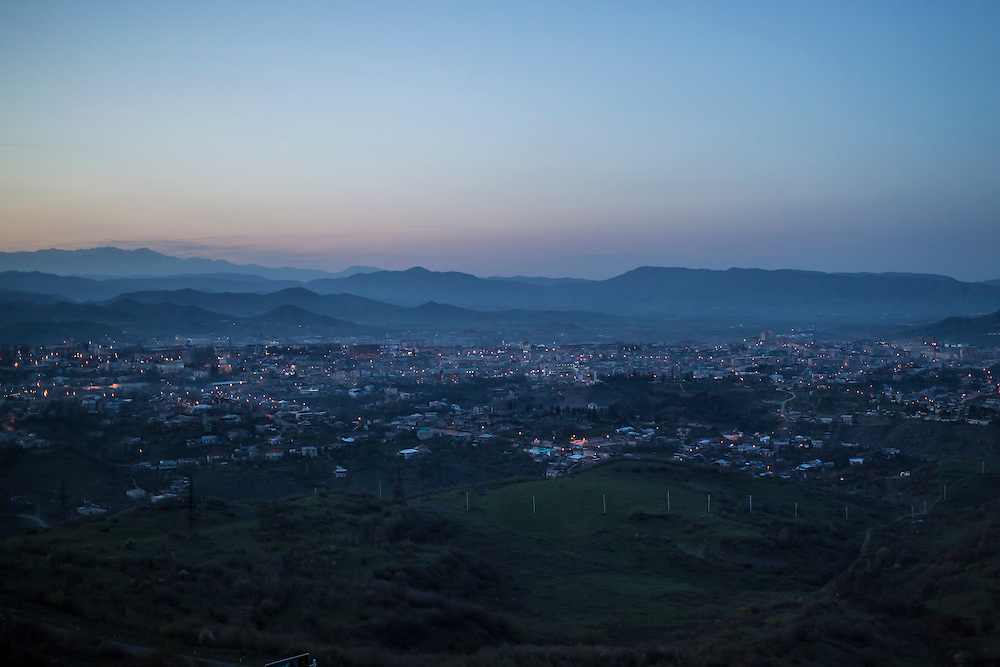 STEPANAKERT, NAGORNO-KARABAKH - APRIL 18: A view of the city of Stepanakert, capital of the self-delcared independent Nagorno-Karabakh Republic, at dusk on April 18, 2015 in Stepanakert, Nagorno-Karabakh. Since signing a ceasefire in a war with Azerbaijan in 1994, Nagorno-Karabakh, officially part of Azerbaijan, has functioned as a self-declared independent republic and de facto part of Armenia, with hostilities along the line of contact between Nagorno-Karabakh and Azerbaijan occasionally flaring up and causing casualties. (Photo by Brendan Hoffman/Getty Images) *** Local Caption ***