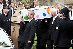 © Licensed to London News Pictures. 19/07/2012. Oldham , UK . The funeral of 2 year old Jamie Heaton , who was killed in a blast in his home on 26/06/2012 . Jamie Heaton's coffin is carried away from the church at the end of the service . Photo credit : Joel Goodman/LNP