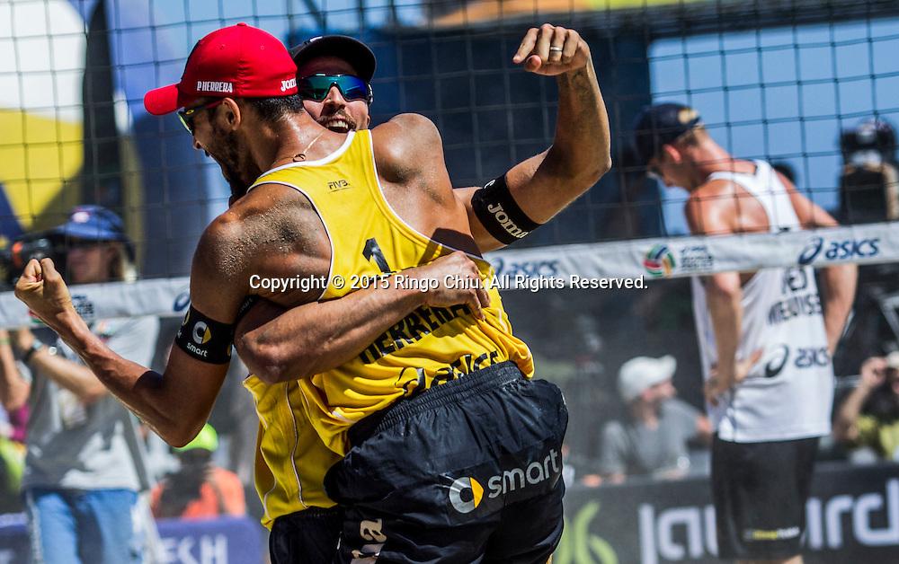 The Spanish Pablo Herrera (1),and Adrian Gavira (2) celebrates winning the bronze medal during the World Series of Beach Volleyball against Netherland in Long Beach, California, Sunday, August. 23, 2015.