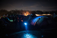 The only light sources in the camps are torches and wood fires. Grande Synthe, France. FEDERICO SCOPPA/CAPTA