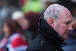 """© Licensed to London News Pictures . 19/01/2013 . Manchester , UK . A man with a tattoo on his head that reads """"English and proud """" attends the demonstration . Loyalist protesters demonstrate outside Manchester Town Hall in the city's Albert Square , today (19th January 2013) . Photo credit : Joel Goodman/LNP"""