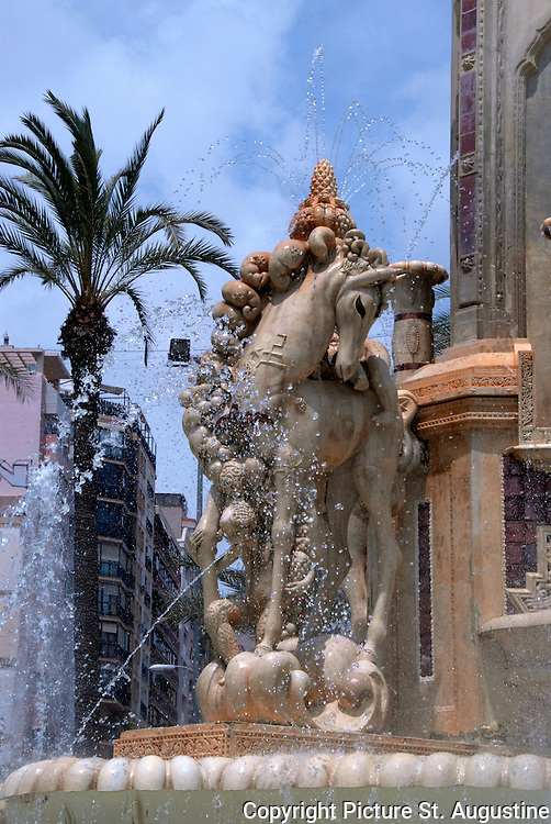 The Monument and Fountain in the Plaza de los Luceros on a beautiul spring day in Alicante, Spain