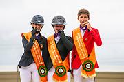 Podium Juniors 2. Maya de la Joya Fernandez Longoria, 1. Kate Derwin, 3. Thibeau Spits<br /> FEI European Championships 2019<br /> © DigiShots
