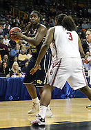 24 MARCH 2009: Georgia Tech center Sasha Goodlett (45) eyes the basket as Oklahoma center Courtney Paris (3) defends during an NCAA Women's Tournament basketball game Tuesday, March 24, 2009, at Carver-Hawkeye Arena in Iowa City, Iowa. Oklahoma defeated Georgia Tech 69-50.