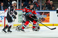 KELOWNA, BC - DECEMBER 18: Matthew Wedman #20 of the Kelowna Rockets looks for the pass ahead of the net of David Tendeck #30 as Seth Bafaro #27 of the Vancouver Giants looks to block a shot at Prospera Place on December 18, 2019 in Kelowna, Canada. (Photo by Marissa Baecker/Shoot the Breeze)