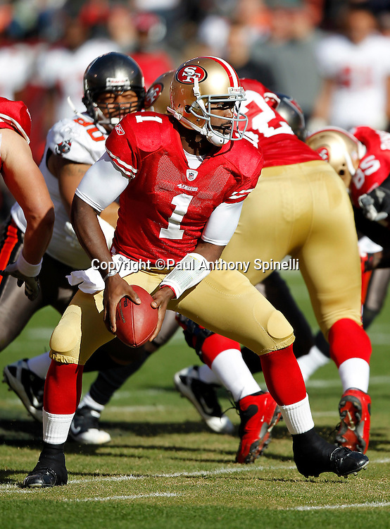 San Francisco 49ers quarterback Troy Smith (1) looks to pitch out the ball on a running play during the NFL week 11 football game against the Tampa Bay Buccaneers on Sunday, November 21, 2010 in San Francisco, California. The Bucs won the game 21-0. (©Paul Anthony Spinelli)