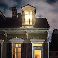 Old house windows illuminated at night