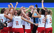 England players celebrate defeating New Zealand after an extra time penalty shootout during the Black Sticks Women v England Semi Final match at the Glasgow National Hockey Stadium. Glasgow Commonwealth Games 2014. Friday 1 August 2014. Scotland. Photo: Andrew Cornaga/www.Photosport.co.nz