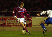 06/12/2003 - Photo  Peter Spurrier.FA Cup 2nd Rd - Northampton v Weston S Mare.Martin Smith looks to go through the gap.