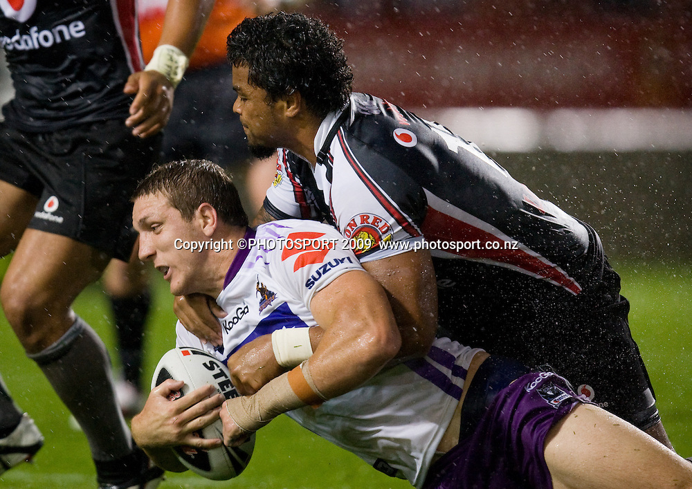 Storm player Ryan Hoffman is tackled by Epalahame Lauaki during the NRL pre season rugby league trial match between Vodafone Warriors and Melbourne Storm, won by the Warriors 24-12 at Waikato Stadium, Hamilton, New Zealand, Tuesday 12 February 2009.  Photo: Stephen Barker/PHOTOSPORT