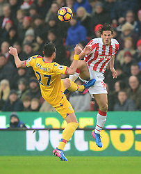 Damien Delaney of Crystal Palace battles for a high ball with Ramadan Sobhi of Stoke City - Mandatory by-line: Alex James/JMP - 11/02/2017 - FOOTBALL - Bet365 Stadium - Stoke-on-Trent, England - Stoke City v Crystal Palace - Premier League