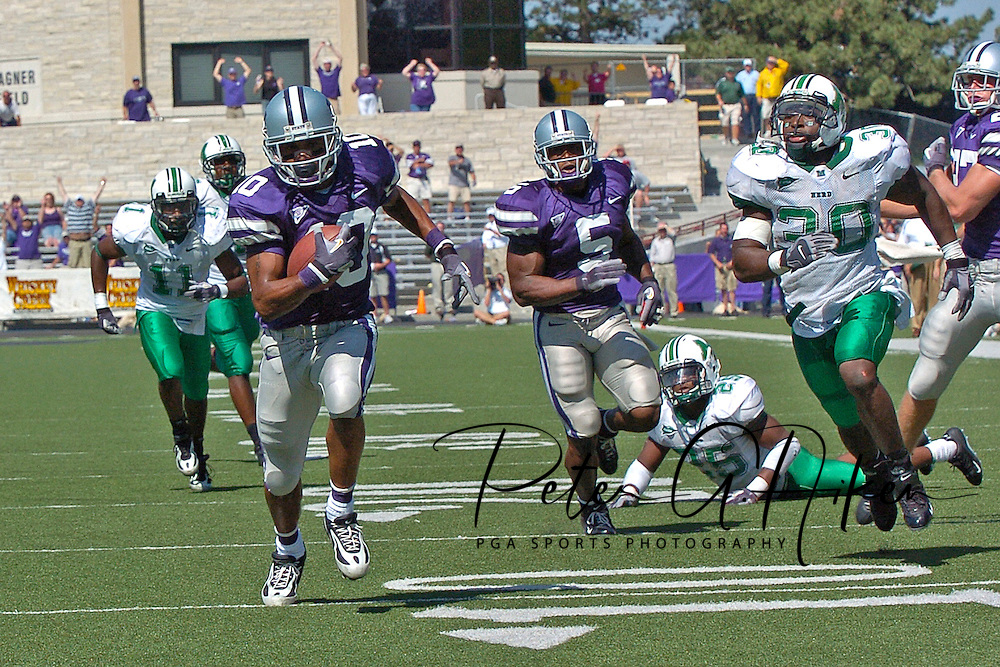 Kansas State wide receiver Jermaine Moreira (10) races past Marshall's Dennnis Thornton (30) for a 44-yard touchdown in the fourth quarter, at Bill Snyder Family Stadium in Manhattan, Kansas, September 16, 2006.  The Wildcats beat the Thundering Herd 23-7.
