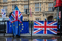 © Licensed to London News Pictures. 02/04/2019. London, UK. Anti-Brexit protesters opposite Parliament as rain falls over London. Prime Minister Theresa May is chairing a Cabinet meeting to try and agree a path forward with ministers after MPs voted to reject all alternatives to the Withdrawal Agreement for a second time. Photo credit: Rob Pinney/LNP