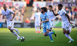 Joe Allen of Stoke City attacks forward under pressure from Kyle Naughton of Swansea City - Mandatory by-line: Alex James/JMP - 22/04/2017 - FOOTBALL - Liberty Stadium - Swansea, England - Swansea City v Stoke City - Premier League