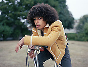 Teenager With Afro On Chopper Bicycle