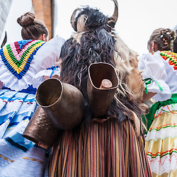 Detail of the dresses and cowbell of the trangas and madamas costumes. Carnival of Bielsa, Huesca, Spain