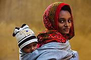An Eritrean refugee mother and child visit the Refuge Egypt medical clinic for baby wellness checkups December 14, 2017 at the All Saints Cathedral office in the Zamalek district of Cairo, Egypt.