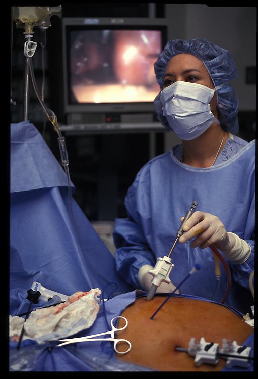 Lori Cupp, who uses tradition as well as inovation, performs gallbladder surgery at a Gallup hospital.  Trust in modern medicine has begun to take hold amoung her people.