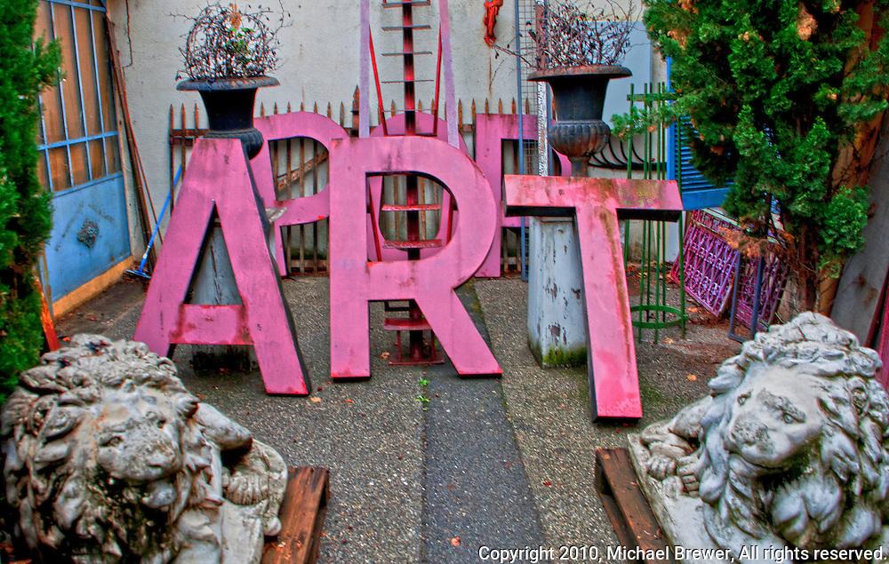 Pop Art lettering and cement lions at l'isle-sur-la-sorge, France.