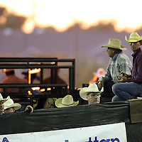 Cowboys wait as the sun sets during the 129th performance of the PRCA Silver Spurs Rodeo at the Silver Spurs Arena   on Friday, June 1, 2012 in Kissimmee, Florida. (AP Photo/Alex Menendez) Silver Spurs rodeo action in Kissimee, Florida. PRCA rodeo event in Florida. The 129th annual running of the cowboy event.