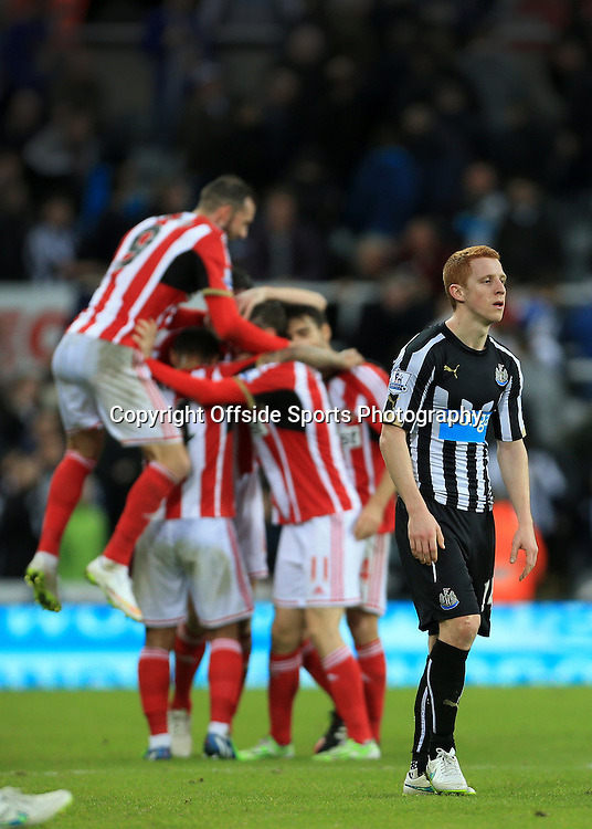 21st December 2014 - Barclays Premier League - Newcastle United v Sunderland - Jack Colback of Newcastle looks dejected as Sunderland players celebrate their victory - Photo: Simon Stacpoole / Offside.