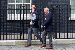 © Licensed to London News Pictures. 16/09/2013. London, UK. Carrying the Tom Richards Trophy, British Lions Rugby Team captain Sam Warburton (L) and Lions coach Warren Gatland are seen on Downing Street in London today (16/09/2013) as they attend a reception celebrating their victory in Australia this summer. Photo credit: Matt Cetti-Roberts/LNP