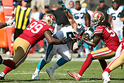 Carolina Panthers rookie running back Christian McCaffrey (22) gets stripped of the ball by San Francisco 49ers cornerback Rashard Robinson (33) as he is tackled by San Francisco 49ers outside linebacker Ray-Ray Armstrong (54) and San Francisco 49ers defensive end DeForest Buckner (99) during the 2017 NFL week 1 regular season football game against the against the San Francisco 49ers, Sunday, Sept. 10, 2017 in Santa Clara, Calif. The Panthers won the game 23-3. (©Paul Anthony Spinelli)