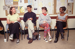 Multiracial group of social work students taking part in training course,