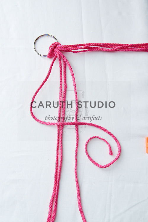 Step one to make a square knot with macrame cord