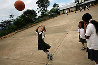 Young girls play basketball in El Ofrio, a small remote village in the mountains of the southern Colombian state of Nariño, on Monday, June 25, 2007. There is still coca fields located in the vicinity of El Ofrio, but the residents know that soon fumigation and manual eradication of their coca crops by the Colombian government will force them to find a new means to earn cash. (Photo/Scott Dalton)