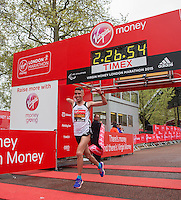 Abderrahman Ait Khamouch of Spain crosses the line to finish first in the IPC Athletics Marathon World Championships T45/46 race at the Virgin Money London Marathon, Sunday 26th April 2015.<br /> <br /> Scott Heavey for Virgin Money London Marathon<br /> <br /> For more information please contact Penny Dain at pennyd@london-marathon.co.uk