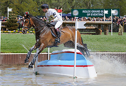 Harry Meade and WILD LONE - Cross Country phase, Mitsubishi Motors Badminton Horse Trials, Badminton House, Gloucestershire, United Kingdom, Saturday, 10th May 2014. Picture by Nico Morgan / i-Images