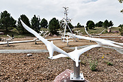 The memorial for the victims of the Aurora theater shooting that killed twelve people and injured seventy others, installed near Aurora Municipal Center in Aurora, Colorado. The memorial was created by artist Douwe Blumberg, and consists of a park-like dell with 83 abstract birds, one for each victim. Thirteen of the birds, with translucent wings, are on a center column and represent the twelve dead and the unborn child killed in the shooting.