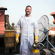 Noah Wilson-Rich, the founder of Best Bees, poses for a portrait on the roof of the Taj Hotel in downtown Boston. Best Bees is an urban beekeeping company. Shot for Tufts Magazine.