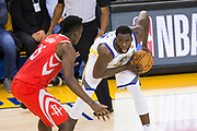 Golden State Warriors forward Draymond Green (23) handles the ball against the Houston Rockets during Game 3 of the Western Conference Finals at Oracle Arena in Oakland, Calif., on May 20, 2018. (Stan Olszewski/Special to S.F. Examiner)