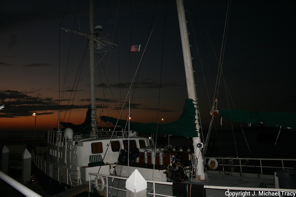 Sunset at a Key West boat dock, a diving boat, sail boat wth all gear aboard. Taken with a soft flash.