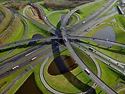 Nederland, Zuid-Holland, Gemeente Ridderkerk, 25-02-2020; Knooppunt Ridderkerk, verkeersknooppunt A15 en A16, bijgenaamd 'Ridderster'. Klaverblad met opritten, afritten en fly-overs. De waterpartijen zijn kunstmatige aangelegd en zorgen voor bluswater ingeval van calamiteiten.<br /> Ridderkerk junction, junction A15 / A16, nicknamed 'Ridder star'. Cloverleaf type junction, with ramps, exit ramps and flyovers. The ponds are man-made, the water can be used for firefighting in case of emergencies.<br /> luchtfoto (toeslag op standard tarieven);<br /> aerial photo (additional fee required)<br /> copyright © 2020 foto/photo Siebe Swart