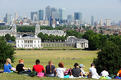 &copy; Licensed to London News Pictures. 06/07/2017<br /> Canary Wharf and National Maritime Museum.<br /> Sunny weather in Greenwich Park, Greenwich, London.<br /> Photo credit: Grant Falvey/LNP