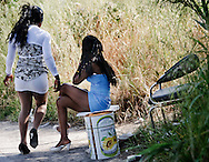 Napoli, Italia - 10 maggio 2010. Prostitute lungo le strade dei comuni che costeggiano il litorale domitio. La maggior parte delle prostitute sono di nazionalita? africana o dei paesi dell'est europeo..Ph. Roberto Salomone Ag. Controluce.ITALY - Prostitutes along the streets of suburbs of Naples are seen on May 10, 2010.