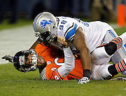 Detroit Lions defensive tackle Nick Fairley (98) lands hard on grimacing Chicago Bears quarterback Jay Cutler (6) in the end zone and draws a penalty for unnecessary roughness during the NFL week 10 football game against the Chicago Bears on Sunday, November 13, 2011 in Chicago, Illinois. The Bears won the game 37-13. ©Paul Anthony Spinelli