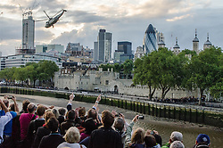 © Licensed to London News Pictures. 20/07/2012. London, UK.  London 2012 Olympics.  Crowds of spectators line Tower bridge as the Olympic Torch arrives in London, flown by Royal Navy Sea King helicopter to the Tower of London and abseiled down by a Royal Marine Commando. Photo credit : Richard Isaac/LNP