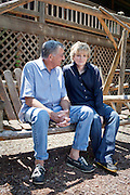 Top selling author Karin Slaughter does all her writing in a cabin in Epworth, Georgia. Her father Howard built the 2,400 square foot cabin for her. The two sit on a wooden swing in the back of the cabin June 13, 2010..CREDIT: Kendrick Brinson/LUCEO.KarinSlaughter