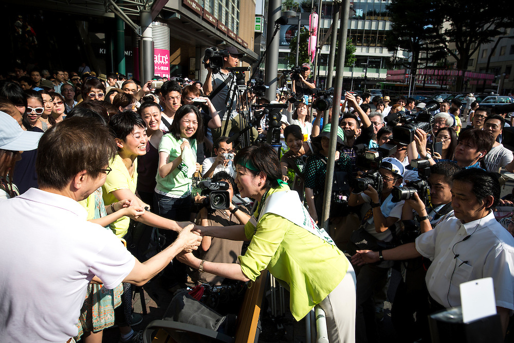TOKYO, JAPAN - JULY 18 : Candidate Yuriko Koike, a Liberal Democratic Party lawmaker and former defense minister greets people as she kicks off her campaign for the July 31 Tokyo gubernatorial election in front of Ebisu Station, Tokyo, Japan on Monday, July 18, 2016. (Photo:  Richard Atrero de Guzman/NUR Photo)