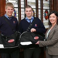 The final of the Avonmore Munster Schools Senior Rugby Cup on St Patricks Day is between St Munchins College , Limerick and PBC (Cork). Members of the St Munchins team Liam Og Murphy (from Ennis) (left) and  Ronan Costello  (Ardnacrusha) were presented with kit bags by  Mairead Flynn of Avonmore at a reception in the college . - Photo : Kieran Clancy / PicSure ©    9/3/06  <br />**NO FEE Issued with compliments of Avonmore/Munster Rugby.