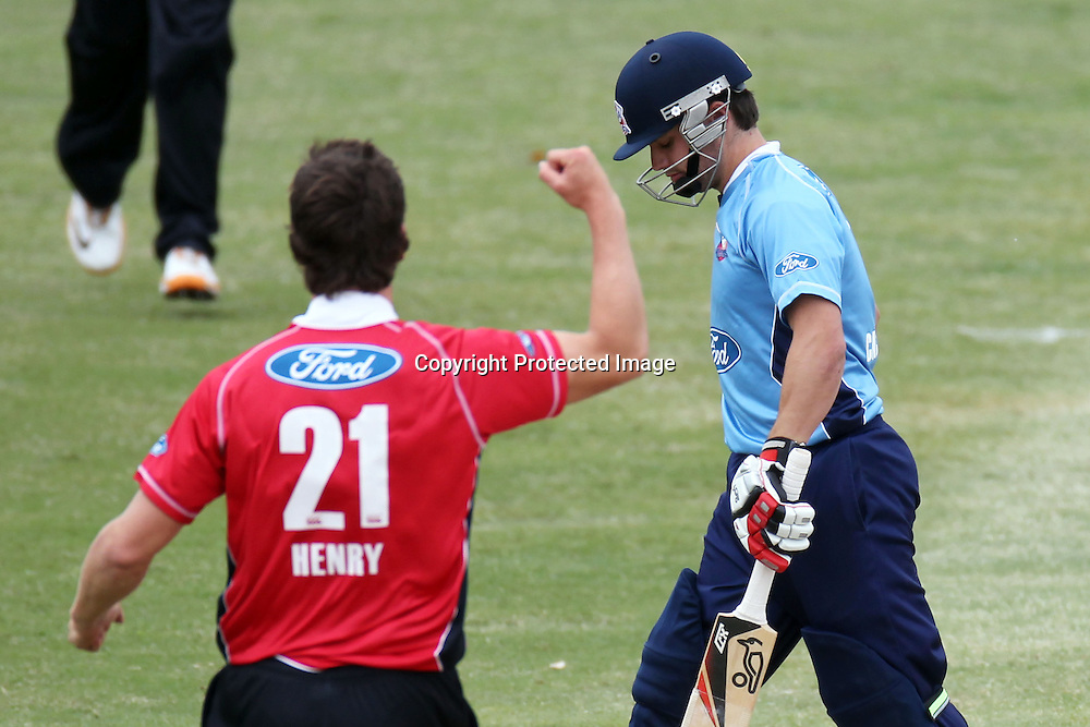 Brad Cachopa walks to the pavilion as Matt Henry celebrates his wicket  during the Ford Trophy match between the Auckland Aces and Canterbury Wizards. Men's domestic one day cricket. Colin Maiden Park, Auckland, New Zealand. Wednesday 14 December 2011. Ella Brockelsby / photosport.co.nz