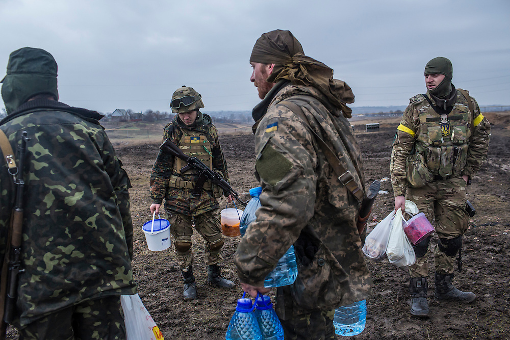 TALAKIVKA, UKRAINE - FEBRUARY 5, 2015: Members of the St. Mary's Battalion, a pro-Ukraine militia, bring food and other supplies to one of the group's front-line encampments in Talakivka, Ukraine. With more than 220 people having died in the past several weeks, a new diplomatic push is underway to bring an end to fighting between pro-Russia rebels and Ukrainian forces. CREDIT: Brendan Hoffman for The New York Times