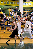 1/6/2006: Bryan Freshwater of the Central Washington Wildcats looks to make a pass in the lane as the  Central Washington Wildcats drop a conference game 80-60 to the University of Alaska-Anchorage Seawolves at the Wells Fargo Sports Complex on the campus of UAA.<br />