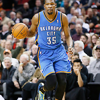 04 December 2013: Oklahoma City Thunder small forward Kevin Durant (35) brings the ball upcourt during the Portland Trail Blazers 111-104 victory over the Oklahoma City Thunder at the Moda Center, Portland, Oregon, USA.