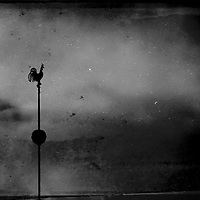 A night scene with cockeral weather vane and moon